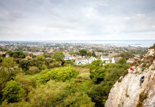 South Dublin climbers with view across Dun Laoghaire